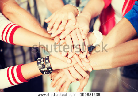 stock-photo-success-and-gesture-concept-close-up-of-teenagers-hands-on-top-of-each-other-outdoors-199821536