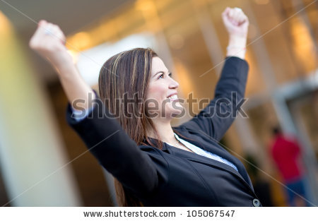 stock-photo-successful-business-woman-with-arms-up-celebrating-105067547
